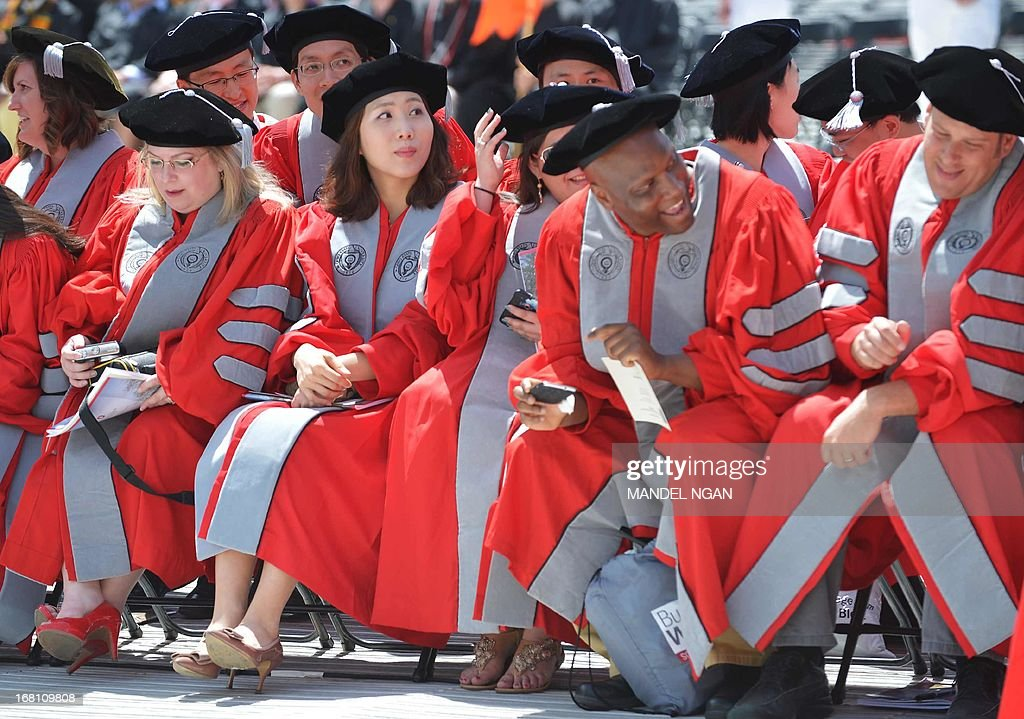 Graduate students wait for the start of the commencement ceremony at Ohio State University on May 5, 2013 in Columbus, Ohio. AFP PHOTO/Mandel NGAN