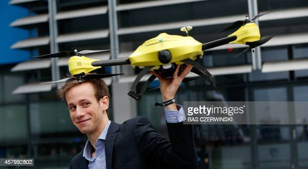Graduated TU Delft student Alec Momont shows his design of an ambulance drone with a built in defibrillator in Delft on October 28 2014 The small...