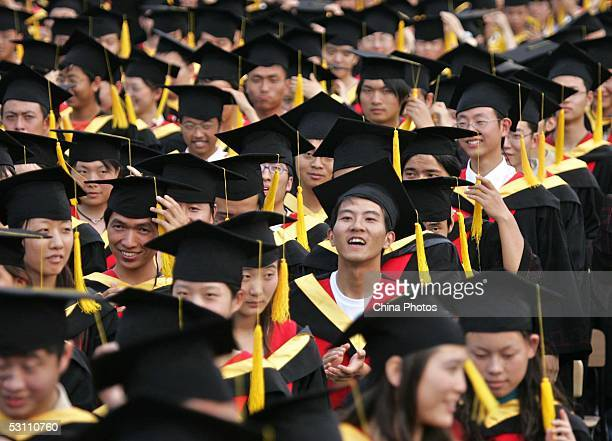 Graduates attend a graduation ceremony at Shanghai Jiaotong University on June 20 2005 in Shanghai China According to the Ministry of Education about...