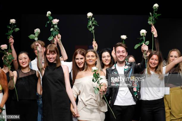 Graduates celebrate on the runway after the AMD Exit17_2 show during Platform Fashion July 2017 at Areal Boehler on July 23 2017 in Duesseldorf...