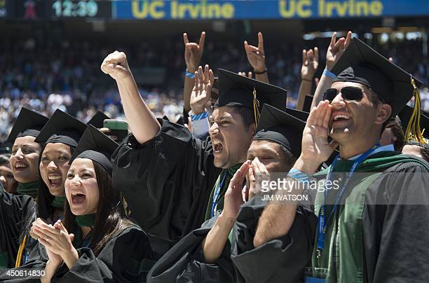 Graduates cheer after US President Barack Obama delivered the commencement address at the University of California Irvine in Irvine California June...