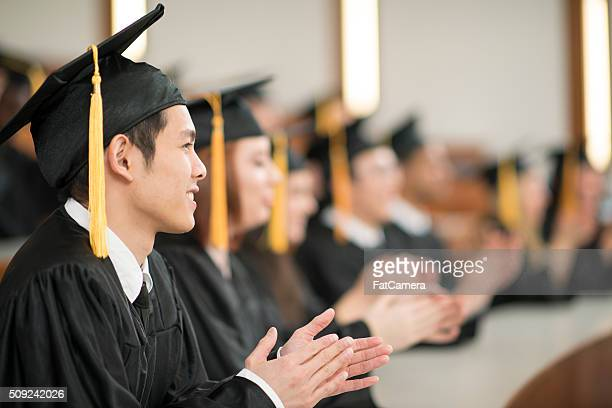 Graduates Clapping During a Commencement Speech