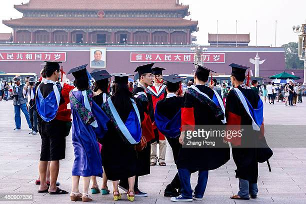 Graduates from Peking Union Medical College take commemorative photos in Tienanmen Square In 2014 727 million students will graduate from China's...