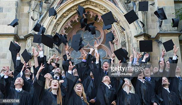 Graduates in gown and caps celebrate their graduation at the HHL Leipzig Graduate School of Management on August 30 2014 in Leipzig Germany A total...