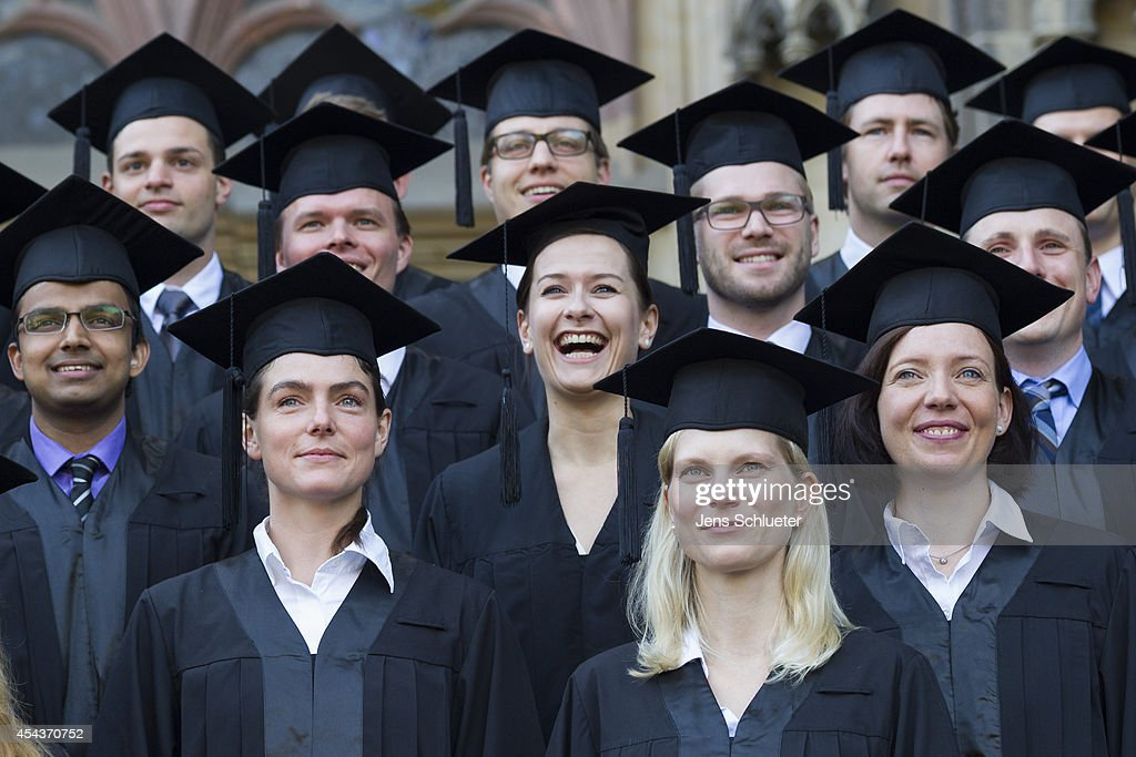 Graduates in gown and caps celebrate their graduation at the HHL Leipzig Graduate School of Management on August 30, 2014 in Leipzig, Germany. A total of 167 students in various Masters programs of business management graduated today, including the regular MBA program, whose students are 80% from foreign countries, while the more advanced graduate programs have a higher percentage of German-born students.