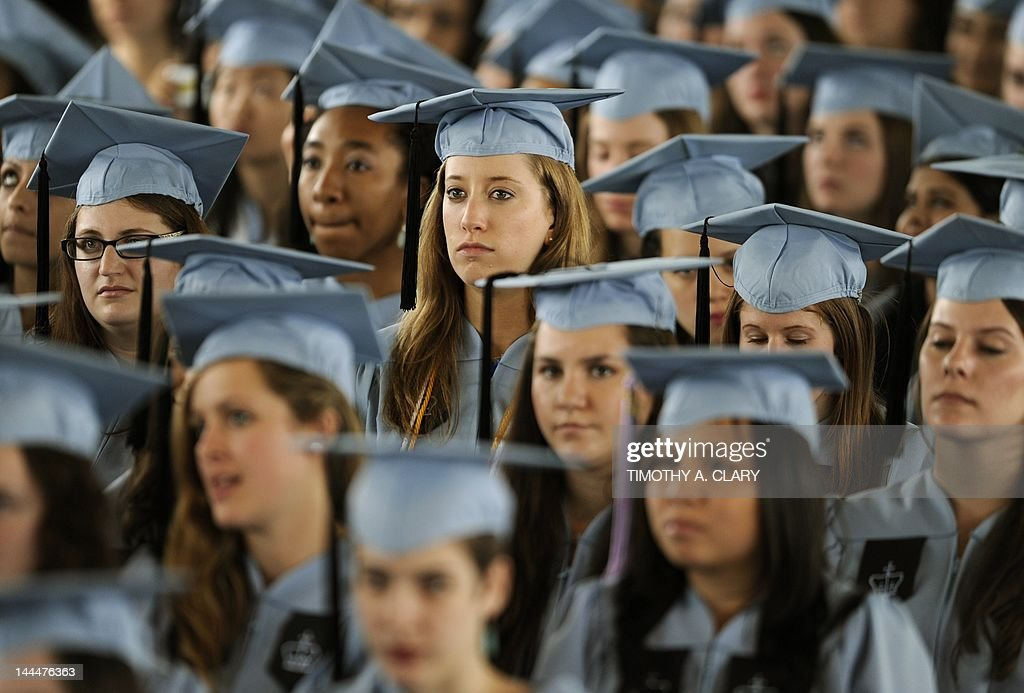 Graduates listen to US President Barack Obama as he delivers the Commencement Address at Barnard College's graduation ceremony in New York on May 14...