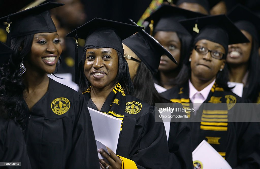 Graduates of Bowie State University arrive for the school's graduation ceremony at the Comcast Center on the campus of the University of Maryland May 17, 2013 in College Park, Maryland. First lady Michelle Obama delivered the commencement speech for the 600 graduates of Maryland's oldest historically black university and one of the ten oldest in the country.