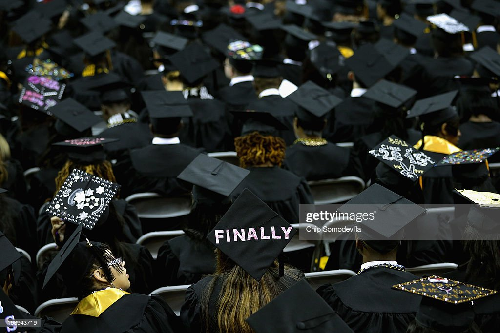 Graduates of Bowie State University put messages on their mortarboard hats during the school's graduation ceremony at the Comcast Center on the campus of the University of Maryland May 17, 2013 in College Park, Maryland. First lady Michelle Obama delivered the commencement speech for the 600 graduates of Maryland's oldest historically black university and one of the ten oldest in the country.