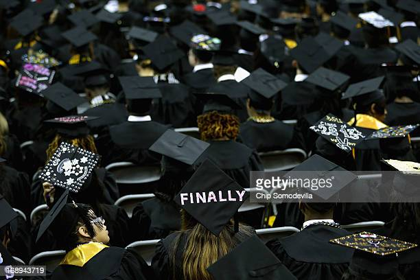 Graduates of Bowie State University put messages on their mortarboard hats during the school's graduation ceremony at the Comcast Center on the...