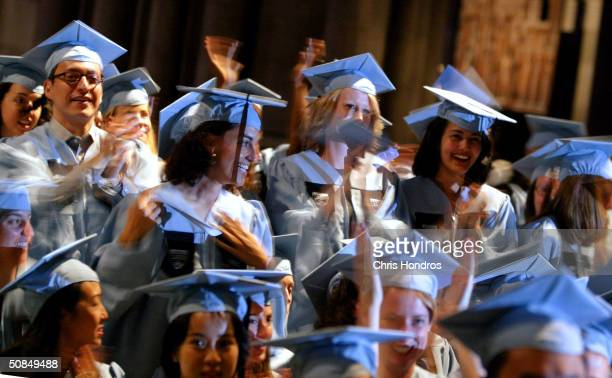 Graduates of Columbia University's lauded School of International and Public Affairs celebrate at SIPA's commencement exercises at St John the Divine...