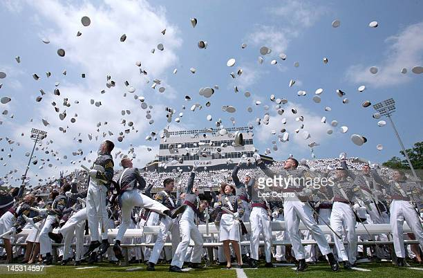 Graduates of The United States Military Academy throw up their hats at the end off the commencement ceremony May 26 2012 in West Point New York US...