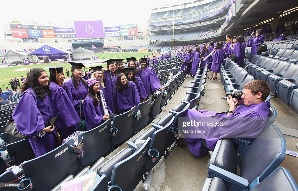 Graduates pose after New York University's commencement ceremony at Yankee Stadium on May 16, 2012 in the Bronx borough of New York City. U.S. Supreme Court Justice Sonia Sotomayor spoke to a crowd of more than 27,000 at the ceremony and was raised in a Bronx housing project not far from the stadium.