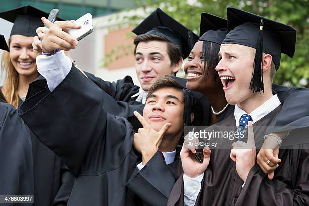 Graduates posing together outdoors
