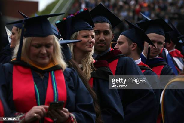 Graduates wait for the beginning of a commencement at Liberty University May 13 2017 in Lynchburg Virginia President Donald Trump is the first...
