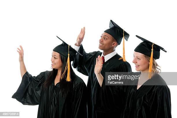 Graduates Waving Together