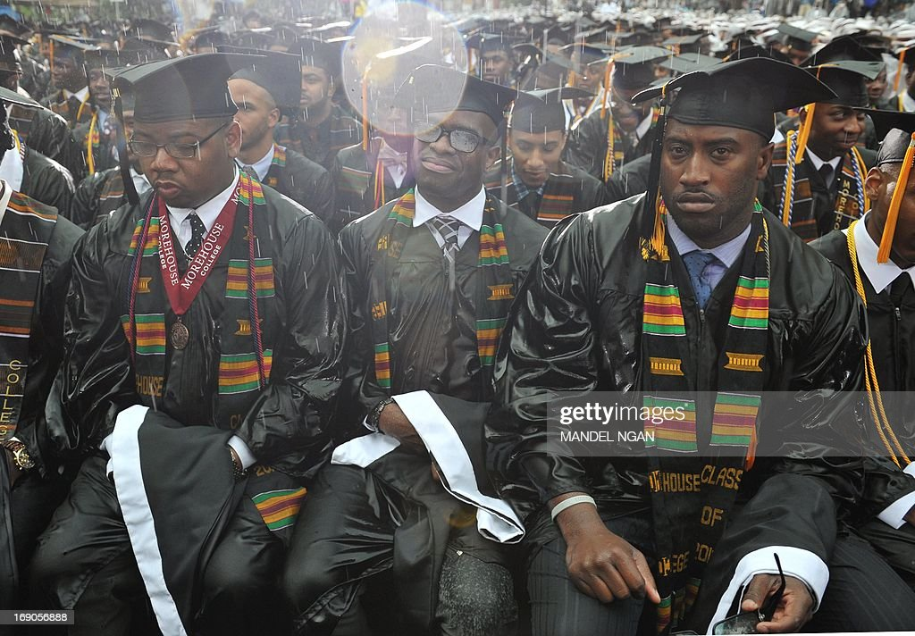Graduating student sit in a driving rain as US President Barack Obama delivers the commencement address during a ceremony at Morehouse College on May 19, 2013 in Atlanta, Georgia. AFP PHOTO/Mandel NGAN