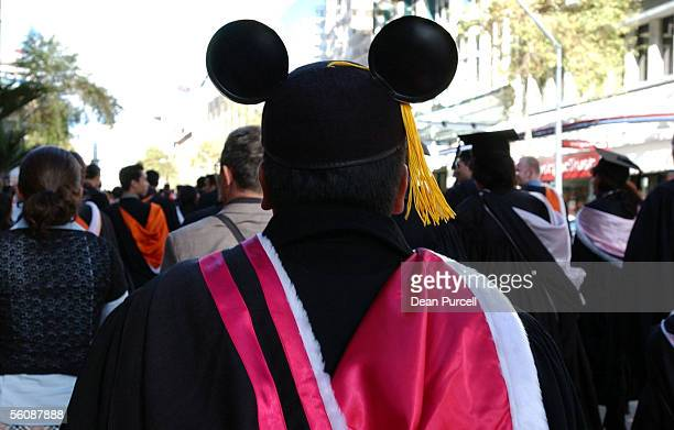 Graduating student Yezdi Mistry thinks Mickey Mouse makes a better graduation cap during the Auckland University graduation march that takes place...