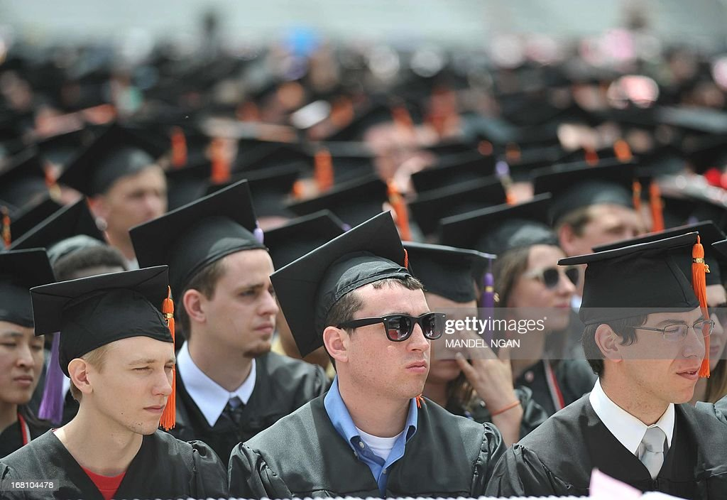 Graduating students are seen during the commencement ceremony at Ohio State University on May 5, 2013 in Columbus, Ohio. US President Barack Obama gave the commencement address. AFP PHOTO/Mandel NGAN