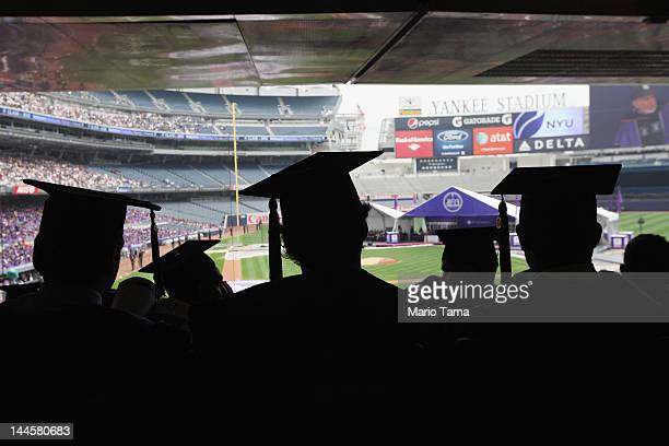 Graduating students attend New York University's commencement ceremony at Yankee Stadium on May 16 2012 in the Bronx borough of New York City US...