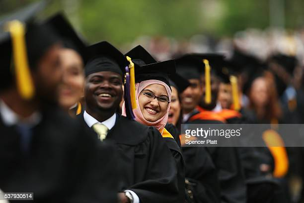 Graduating students participate in commencement exercises at City College where First lady Michelle Obama delivered the commencement speech after...