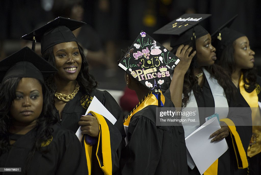 Graduating students scan the auditorium for their family and friends as they process into the hall for the 2013 Spring Commencement speech at Bowie State University held at the University of Maryland's Comcast Center in College Park, Maryland, on Friday, May 17, 2013.