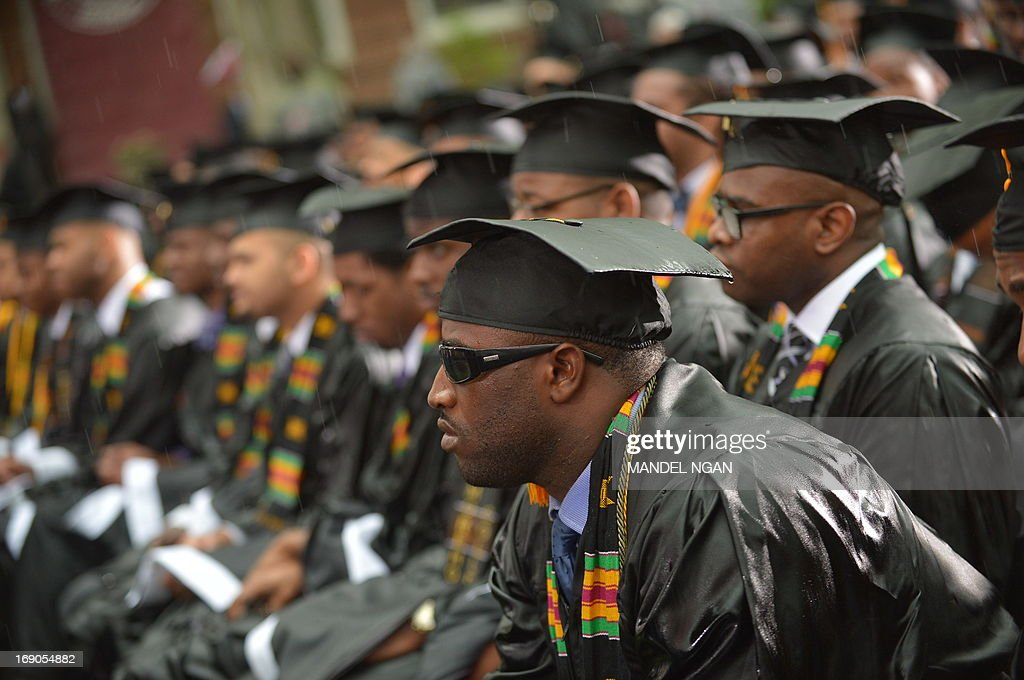 Graduating students' with rain soaked mortar boards listen as US President Barack Obama delivers the commencement address during a ceremony at Morehouse College on May 19, 2013 in Atlanta, Georgia. AFP PHOTO/Mandel NGAN