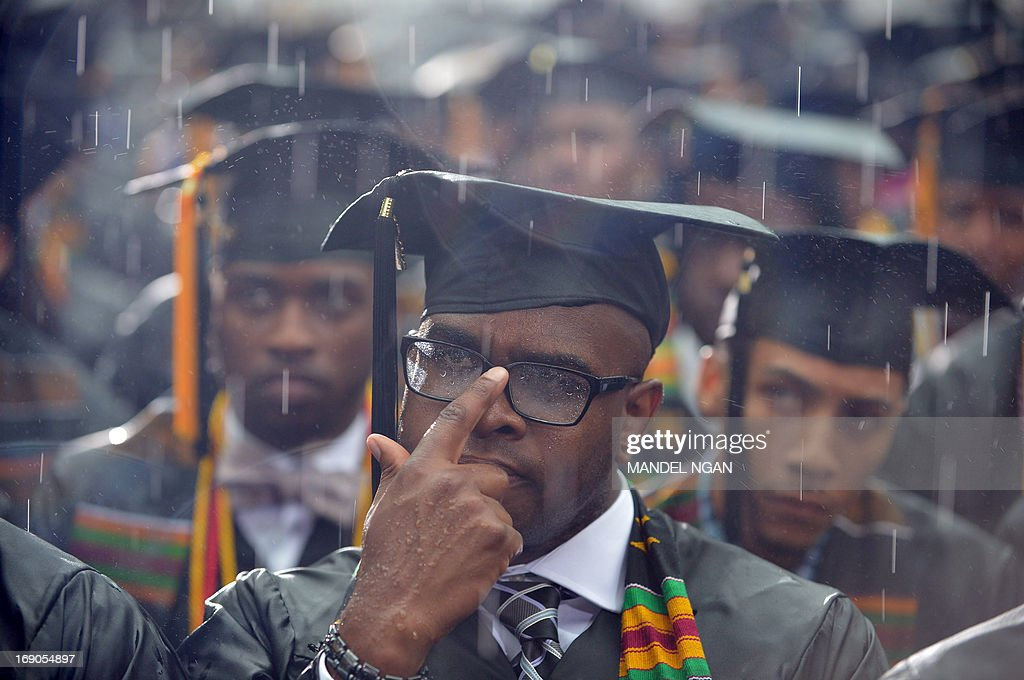 Graduating students' with rain soaked mortar boards, listen as US President Barack Obama delivers the commencement address during a ceremony at Morehouse College on May 19, 2013 in Atlanta, Georgia. AFP PHOTO/Mandel NGAN