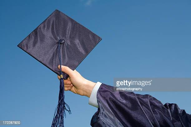 Graduation cap against blue sky