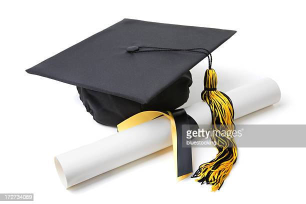Graduation cap with a tassel and a rolled diploma