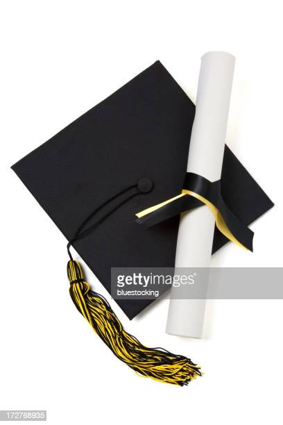 Graduation hat and diploma scroll