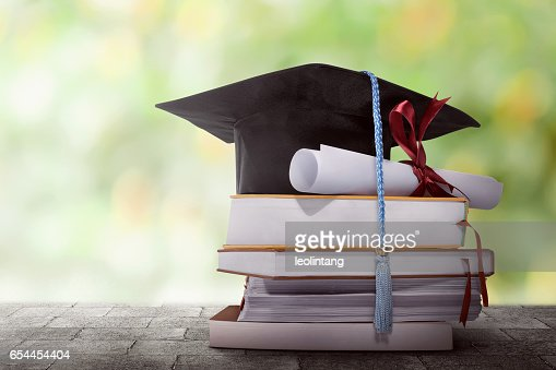 Graduation hat with degree paper on a stack of book : Stock Photo