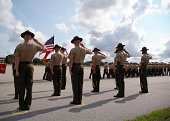 Dramatic shot of Drill Instructors saluting the U.S. flag during the graduation of recruits from US Marine Corps Recruit Depot, Parris Island, SC.