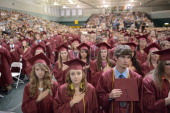 Gradutates listen to then national anthem during the Joplin High School Commencement Ceremony May 21 2012 at Missouri Southern State University in...