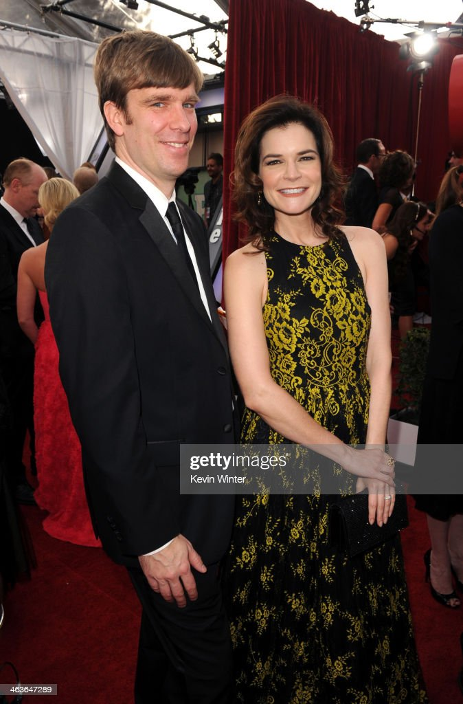 Grady Olsen and actress <a gi-track='captionPersonalityLinkClicked' href=/galleries/search?phrase=Betsy+Brandt&family=editorial&specificpeople=4819893 ng-click='$event.stopPropagation()'>Betsy Brandt</a> attend 20th Annual Screen Actors Guild Awards at The Shrine Auditorium on January 18, 2014 in Los Angeles, California.