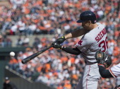 Grady Sizemore of the Boston Red Sox hits a single against the Baltimore Orioles during the second inning at Oriole Park at Camden Yards on March 31...