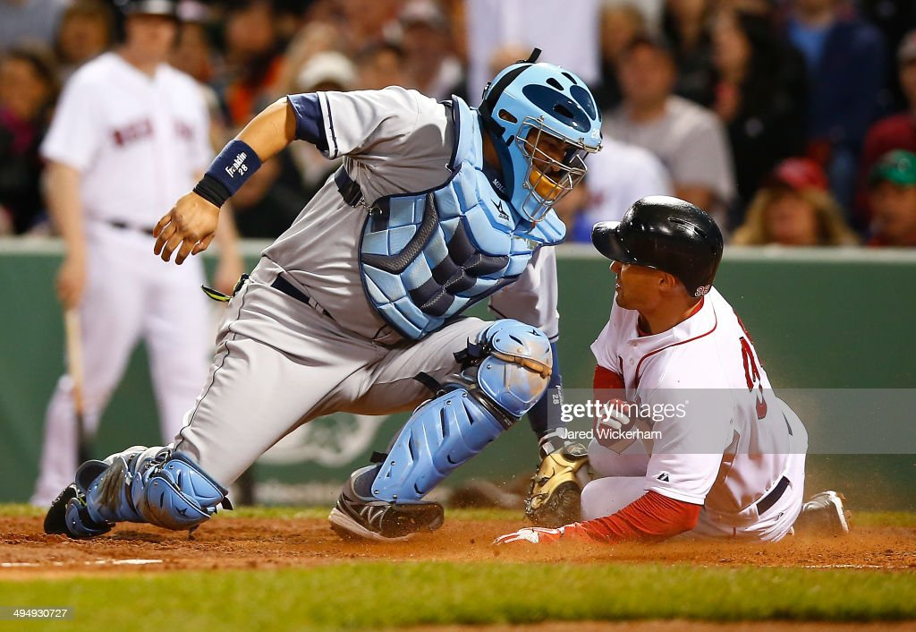 <a gi-track='captionPersonalityLinkClicked' href=/galleries/search?phrase=Grady+Sizemore&family=editorial&specificpeople=215505 ng-click='$event.stopPropagation()'>Grady Sizemore</a> #38 of the Boston Red Sox scores past <a gi-track='captionPersonalityLinkClicked' href=/galleries/search?phrase=Jose+Molina&family=editorial&specificpeople=206365 ng-click='$event.stopPropagation()'>Jose Molina</a> #28 of the Tampa Bay Rays in the fourth inning during the game at Fenway Park on May 31, 2014 in Boston, Massachusetts.