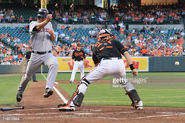 Grady Sizemore of the Cleveland Indians scores a run in front of catcher Matt Wieters of the Baltimore Orioles during the second inning at Oriole...