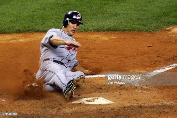 Grady Sizemore of the Cleveland Indians slides into home to score in the fourth inning against the New York Yankees during Game Four of the American...
