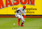 Grady Sizemore of the Philadelphia Phillies commits a seventh inning tworun error on a ball hit by Juan Lagares of the New York Mets at Citi Field on...