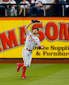 Grady Sizemore of the Philadelphia Phillies commits a seventh inning two run error on a ball hit by Juan Lagares of the New York Mets at Citi Field...