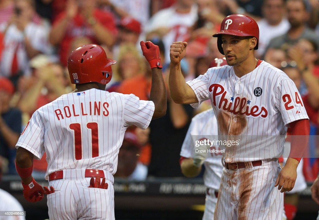 <a gi-track='captionPersonalityLinkClicked' href=/galleries/search?phrase=Grady+Sizemore&family=editorial&specificpeople=215505 ng-click='$event.stopPropagation()'>Grady Sizemore</a> #24 of the Philadelphia Phillies congratulates teammate <a gi-track='captionPersonalityLinkClicked' href=/galleries/search?phrase=Jimmy+Rollins&family=editorial&specificpeople=204478 ng-click='$event.stopPropagation()'>Jimmy Rollins</a> #11 on a two-run home run in the third inning against the Washington Nationals at Citizens Bank Park on July 11, 2014 in Philadelphia, Pennsylvania.