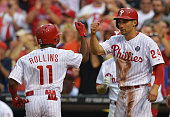 Grady Sizemore of the Philadelphia Phillies congratulates teammate Jimmy Rollins on a tworun home run in the third inning against the Washington...