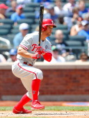 Grady Sizemore of the Philadelphia Phillies follows through on a third inning base hit against the New York Mets at Citi Field on July 30 2014 in the...