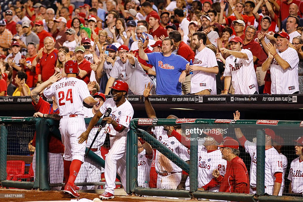 <a gi-track='captionPersonalityLinkClicked' href=/galleries/search?phrase=Grady+Sizemore&family=editorial&specificpeople=215505 ng-click='$event.stopPropagation()'>Grady Sizemore</a> #24 of the Philadelphia Phillies is congratulated by teammates in the dugout after hitting a two run home run in the sixth inning of the game against the Washington Nationals at Citizens Bank Park on August 27, 2014 in Philadelphia, Pennsylvania. The Phillies won 8-4.