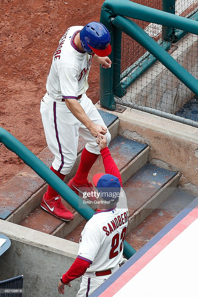 <a gi-track='captionPersonalityLinkClicked' href=/galleries/search?phrase=Grady+Sizemore&family=editorial&specificpeople=215505 ng-click='$event.stopPropagation()'>Grady Sizemore</a> #24 of the Philadelphia Phillies is congratulated by Manager <a gi-track='captionPersonalityLinkClicked' href=/galleries/search?phrase=Ryne+Sandberg&family=editorial&specificpeople=206643 ng-click='$event.stopPropagation()'>Ryne Sandberg</a> in the dugout after Sizemore scored a run in the sixth inning of the game against the Washington Nationals at Citizens Bank Park on July 13, 2014 in Philadelphia, Pennsylvania.