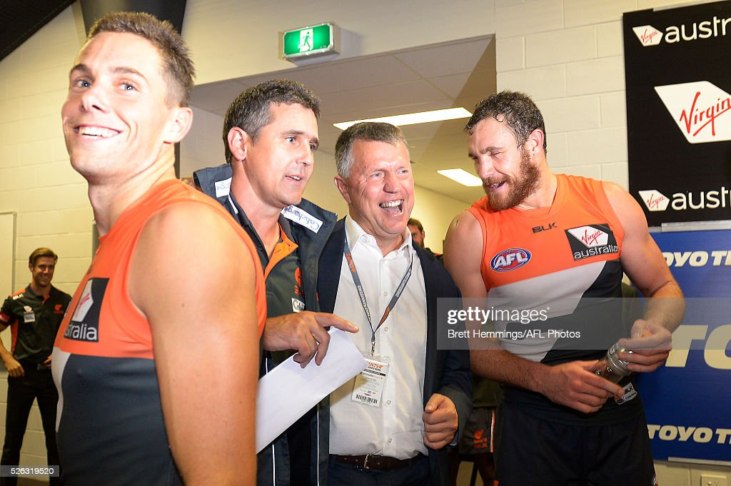 Graeme Allan celebrates victory with Giants coach Leon Cameron and Shane Mumford of the Giants during the round six AFL match between the Greater Western Sydney Giants and the Hawthorn Hawks at Spotless Stadium on April 30, 2016 in Sydney, Australia.
