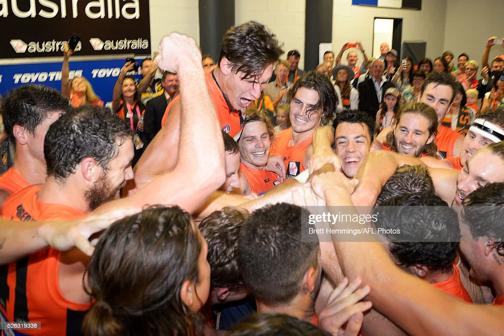 Graeme Allan celebrates with the GWS Giants after victory during the round six AFL match between the Greater Western Sydney Giants and the Hawthorn Hawks at Spotless Stadium on April 30, 2016 in Sydney, Australia.