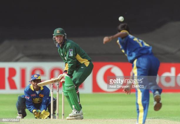 Graeme Archer of Nottinghamshire watches the ball come down the wicket as Sri Lanka wicketkeeper Hashan Tillakaratne looks on
