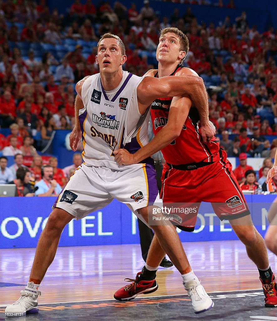 Graeme Dann of the Kings and Michael Vigor of the Wildcats contest for a rebound during the round 22 NBL match between the Perth Wildcats and the Sydney Kings at Perth Arena on March 8, 2013 in Perth, Australia.