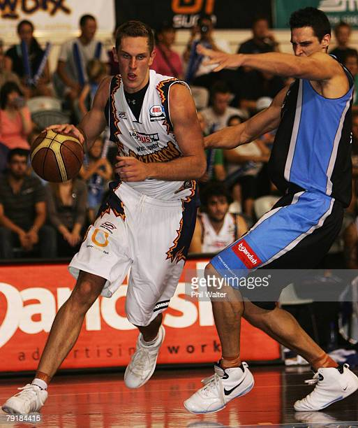 Graeme Dann of the Razorbacks is put under pressure from Brent Charleton of the Breakers during the round 19 NBL match between the New Zealand...